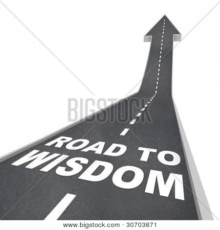 The words Road to Wisdom on a road leading upward to the future, increasing your intelligence and enlightenment through education