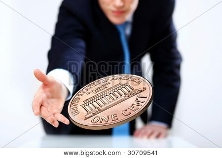 Person throwing a coin as symbol of risk and luck