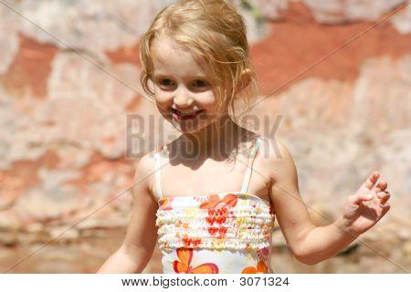 A Little Girl In A Swimsuit