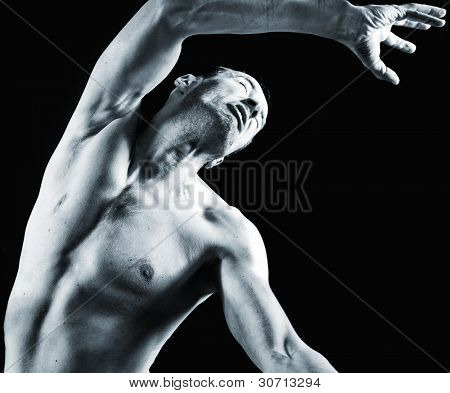 male muscular body in the snatch force (studio photo)