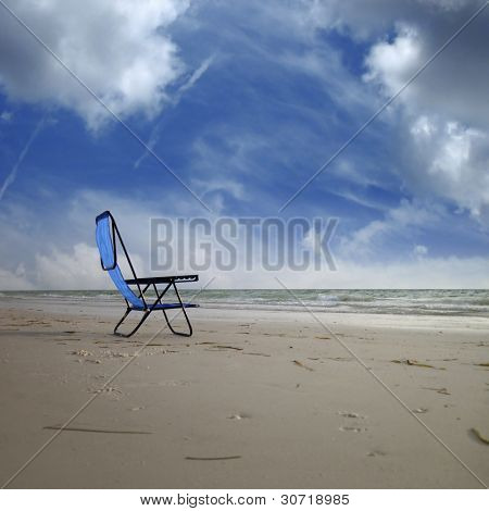close up shot of a single empty deck chair