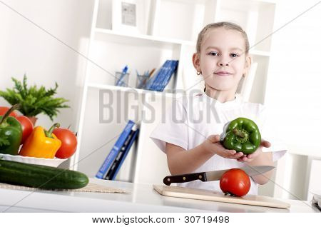 girl in the kitchen cooking vegetables