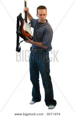 Man Throwing Electric Guitar