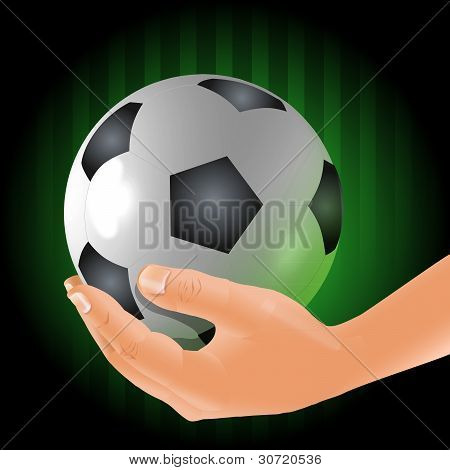 Soccer player holds the ball