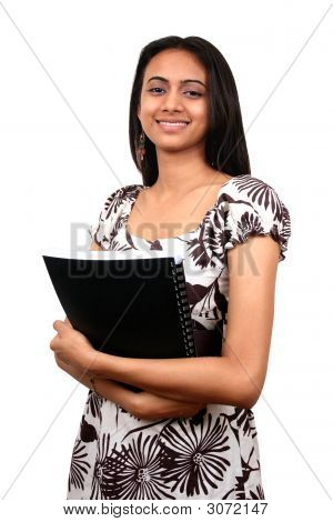 Indian Student With Book In Hand.