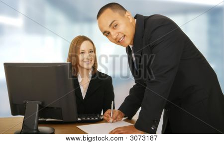 Two Business People In Office