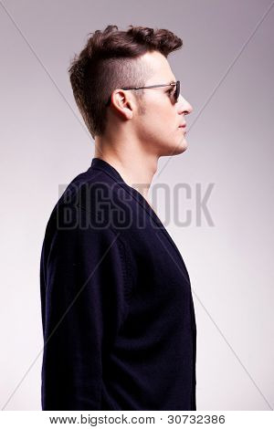 profile picture of a casual young man wearing sunglasses on gray background