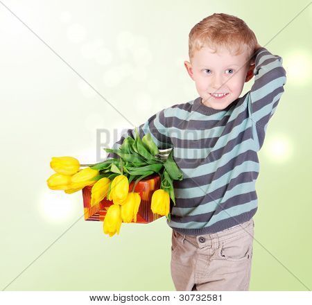 Cute Little Boy With Yellow Tulips And Gift