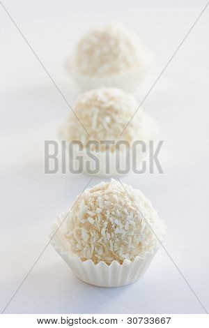 White sweet coconut truffles, close up