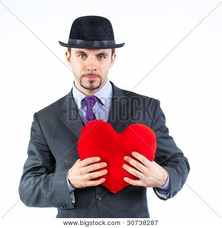 Portrait of a business man with hat and red heart