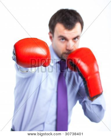 Portrait of a  business man in red boxing gloves