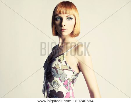 Young beautiful redhead girl with a bob haircut