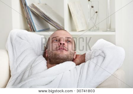 relaxed young man indoors