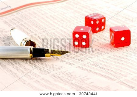 Red Dice And A Golden Pen  On The Financial Newspaper
