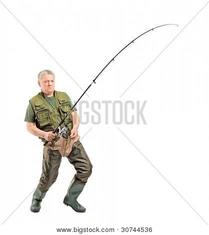 Full length portrait of a mature fisherman holding a fishing pole isolated on white background