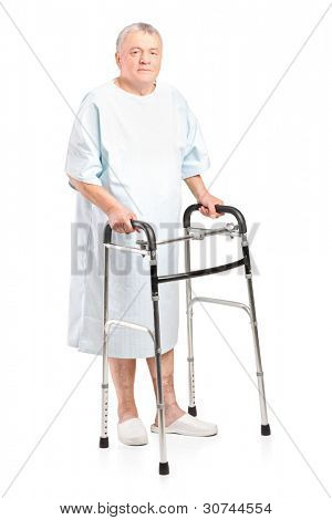 Full length portrait of a senior patient using a walker isolated on white background