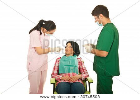 Dentists Explain To Patient