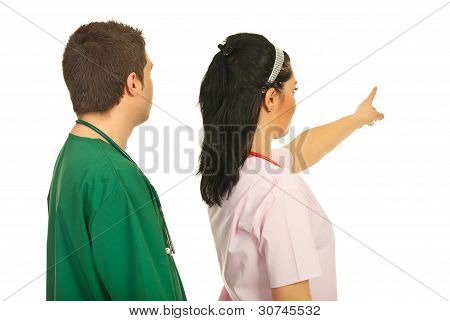 Back Of Doctors Pointing Away