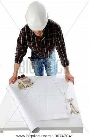 Construction Worker Over Plan Roll