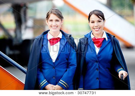 Beautiful flight attendants smiling and ready to fly