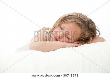 High Key Portrait Of Girl Sleeping.