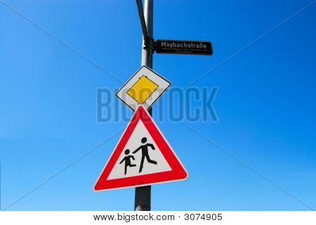 Priority Road And Children Crossing Road Signs