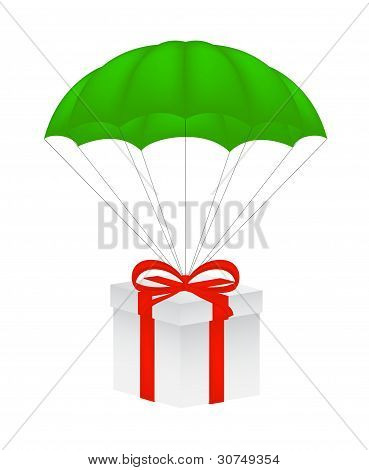Gift box with red bow flying on green parachute