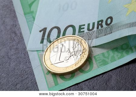Coin and banknotes on black background