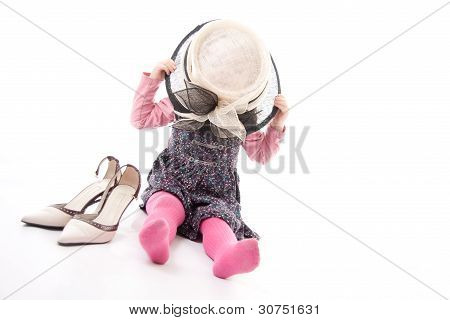 Child playing dress up