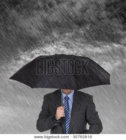 Business man with umbrella