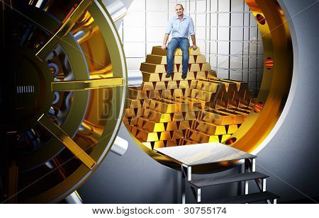 smiling man sit on pile of gold bars