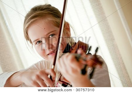 Child Playing Violin At Home