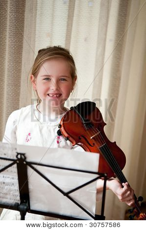 Child Holding Violin At Home