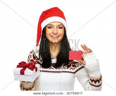 Portrait of beautiful woman in santa hat holding gift box and credit card , isolated on white background
