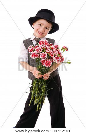 Little boy with a bouquet of carnations