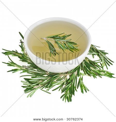 Rosemary herbs tisane in a bowl isolated over white background