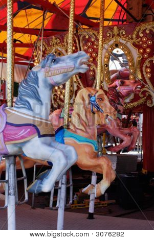 Horses In Carousel, Merry-Go-Round At Carnival Amusement Park