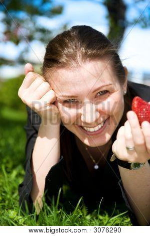 Pretty Girl Eat Red Frash Strawberry On Green