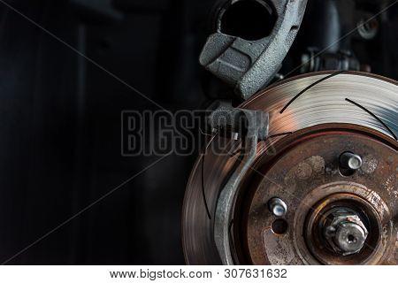 poster of Disc Brake And Asbestos Brake Pads At Car Garage