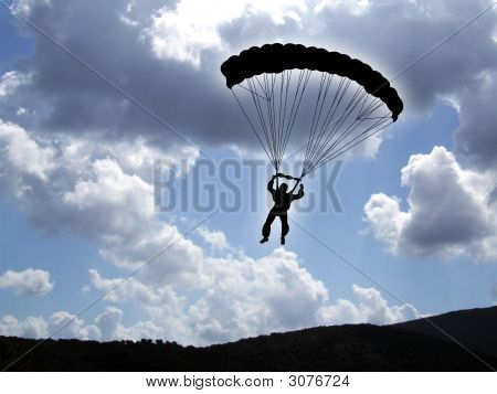 Parachutist On A Cloudy Sky