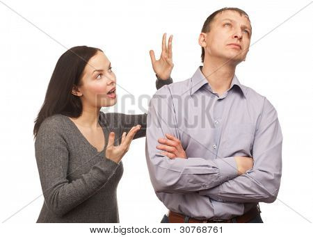 Young couple in quarrel. Wife yelling at her husband, isolated on white background