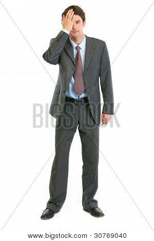 Modern Businessman Closing Eye By Arm