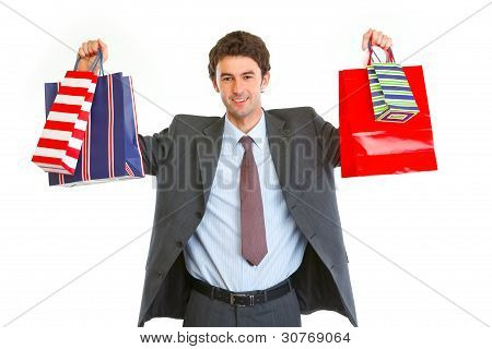 Happy Man In Suit With Shopping Bags In Hands