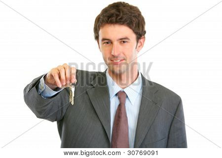 Portrait Of Happy Realtor Giving Keys