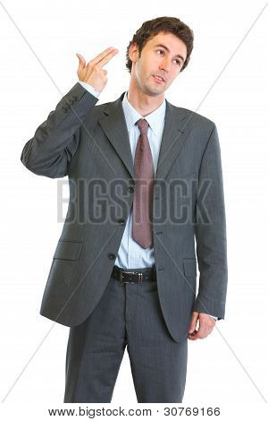 Modern Business Man Shooting Himself With Gun Shaped Hand