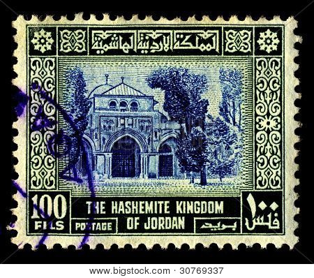 JORDAN-CIRCA 1954:A stamp printed in Jordan shows image of Al-Aqsa Mosque  also known as al-Aqsa, is the third holiest site in Sunni Islam and is located in the Old City of Jerusalem, circa 1954.
