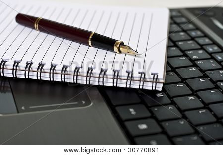 Pen, Notepad And Laptop On The Desk