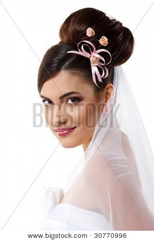 beauty young bride with beautiful makeup na hairstyle in veil over white background
