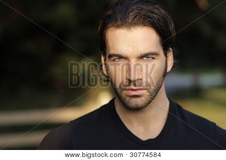 Portrait of  a beautiful man outdoors