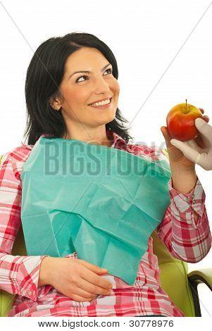 Patient Woman Receiving An Apple